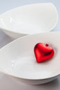 White bowls and red heart Royalty Free Stock Photos