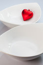 White bowls and red heart two Royalty Free Stock Image