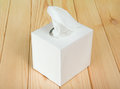 White box with napkins the on wooden table Stock Photography