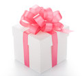 White box with pink ribbon on white background Royalty Free Stock Photo