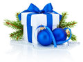 White box tied blue ribbon bow, pine tree branch and christmas balls Royalty Free Stock Photo
