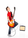 White boy sings and plays on the electric guitar a young with bright emotions isolatade background Royalty Free Stock Images