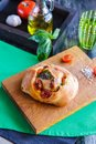 White bread with tomatoes and basil on a cutting board Royalty Free Stock Photo