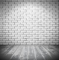 White brick room with wooden floor Royalty Free Stock Photo