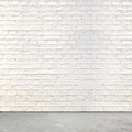 White brick wall and cement floor Royalty Free Stock Photo