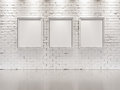 WHITE BRICK WALL with frames for paintings Royalty Free Stock Photo
