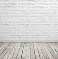 White brick wall and wood floor. Royalty Free Stock Photo