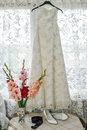 The white bride`s dress, shoes and flowers.