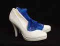 White bride shoes with sexy blue garter Royalty Free Stock Photo