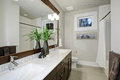 White and brown bathroom design in brand-new home Royalty Free Stock Photo