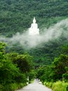The white buddha image on the mountain big thailand Royalty Free Stock Images