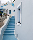 White buildings and blue staircase Royalty Free Stock Photo