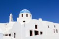 White buildings and church with blue dome in oia or ia on santorini island greece traditional architecture famous tourist Stock Image