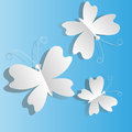 White butterflies from paper on a blue background Royalty Free Stock Photo
