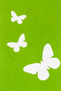 White butterfly painting on green wall background Royalty Free Stock Photo