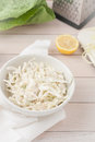 White cabbage cole slaw in white bowl Royalty Free Stock Photo