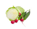 White cabbage cut in half, two cucumbers and red radish Royalty Free Stock Photo