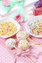 White cake pops on pink dotted table cloth colorful sprinkles in ceramic bowls Stock Photography