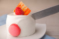 White cake with raspberry and knife Royalty Free Stock Photo
