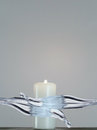 White candle with flame being splashed with water lite on background Stock Images