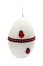 White candle with ladybirds in the from of edds Royalty Free Stock Photo