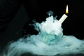 White candle in smoke Royalty Free Stock Photo