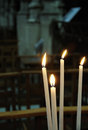 White candles in catholic church Stock Photos