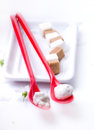 White candy on the red spoon Royalty Free Stock Image