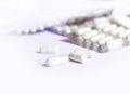 White capsules medicine with package Royalty Free Stock Photo