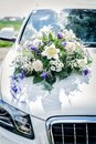 White car with flower bouquet wedding on the cowl Stock Photos