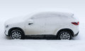 White car suv under snow winter Stock Image