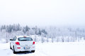 White car winter a in extreme fog conditions Stock Photo