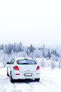 White car a in winter fog conditions Royalty Free Stock Images