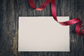 White card with red ribbon Royalty Free Stock Photo