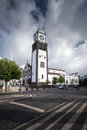 White cathedral clock tower - Azores Portugal Sao Miguel Ponta D