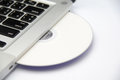 White cd or dvd disk in laptop Royalty Free Stock Photo