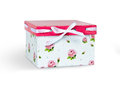 White celebratory box with a pink cap isolated on white Stock Images