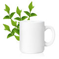 White ceramic mug with herbs herbs drink isolated on a with clipping work path Royalty Free Stock Image