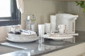 White ceramic set and stainless kitchen utensils on the counter Royalty Free Stock Photo