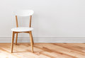 White chair in an empty room elegant with wooden floor Stock Image
