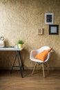 White Chair With Orange Cushion