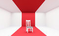 White chair on red in and room Royalty Free Stock Photography