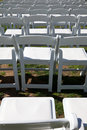 White chairs for outdoor event Stock Image