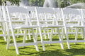 White chairs rows of empty folding sitting on a lawn Royalty Free Stock Images