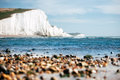 White chalk cliffs as seen from the beach angle with slightly defocused lens fora better accent composition Royalty Free Stock Image