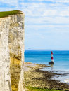White chalk cliffs and Beachy Head Lighthouse, Eastbourne, East Sussex, England Royalty Free Stock Photo