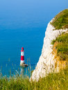 White chalk cliffs and Beachy Head Lighthouse Royalty Free Stock Photo