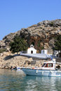 White chapel with boat in Rhodes Royalty Free Stock Images
