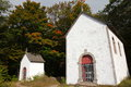 White chapels built in during french colonization restored in oka park near montreal canada Stock Photos