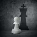 White chess pawn with shadow queen the of a Stock Photography